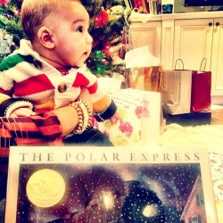 A baby's rite of passage: The Polar Express, with Liam Neeson's narration via CD. Oh, and a HBC sweater.  #Christmas