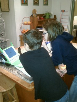 My children, entranced by the OLPC XO.