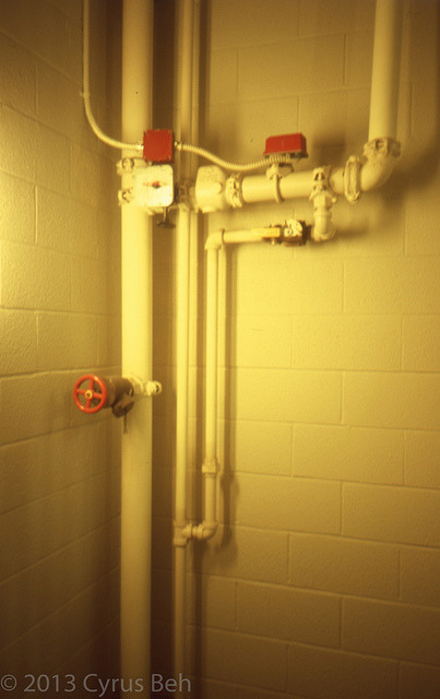 Pipes in the stairwell on Flickr.
