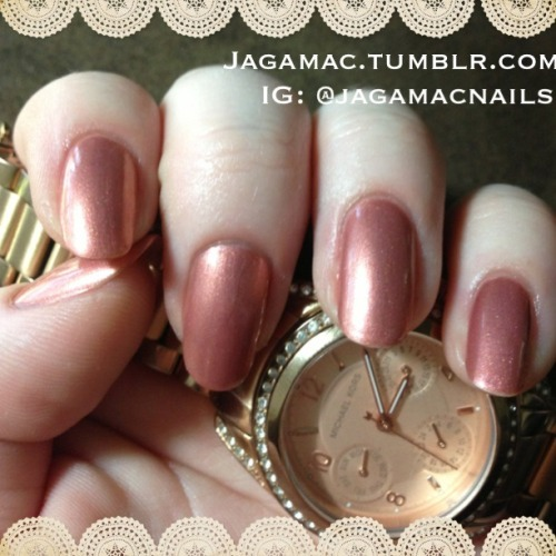 Today's manicure is Dakota by Julep. It's described as a rose gold metallic, but when viewed next to my rose gold watch it seems a bit coppery. Regardless it is a beautiful color and applies quite easily.