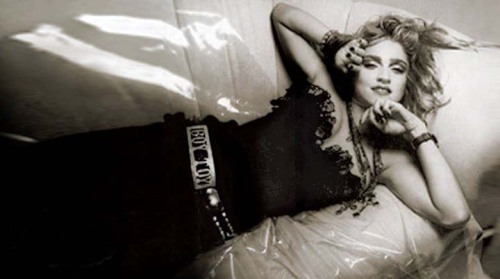 Madonna luxuriating in her bustier and Boy Toy belt buckle in Japan 1985