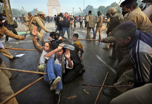politics-war:  Protesters shield themselves as Indian police beat them with sticks during a violent demonstration near the India Gate against a gang rape and brutal beating of a 23-year-old student on a bus last week, in New Delhi, India, Dec. 23.