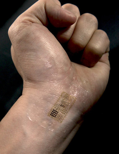 …skin-wearable circuits. They stick on your skin with a stamp. They…stretch and flex with the natural movements of your body, lasting about two weeks until they flake off…And since they're in direct contact with the skin, they can integrate with you more seamlessly than the iPhone, Nike+ Fuelband or any other wearable product that's been conceived to date.  more.