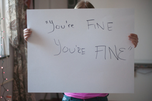 "The poster reads:  ""You're fine. You're FINE.""  — Photographed in Buffalo, NY on October 25th. — Click here to learn more about Project Unbreakable. (trigger warning) Facebook, Twitter, submissions, FAQ, donate to Project Unbreakable, join our mailing list"