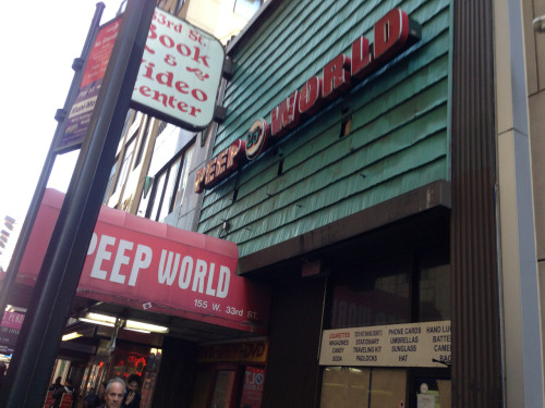 "Photo a Whenever: Photo 119. This is Peep World, a sex store, peep show, and strip club near Penn Station that closed down March 26th 2012. The story below covers Peep Worlds last day of business, highlighting some of the deals.  ""All DVDs are $5 (except for the bestiality movies, which go for $10)."" One commenter on the article wrote: ""this is very sad. there are less and less places one can go to release. life in new york can be lonely and stressful and these booths have got me through the day a few times. i guess the internets easy access to smut put this place under.""   http://vanishingnewyork.blogspot.com/2012/03/peep-world.html?m=1  I couldn't find out when Peep World opened, only that it had been around for ""decades.""  Peep World is a holdover from the days when midtown was filled with porn shops, strip clubs, and crime."
