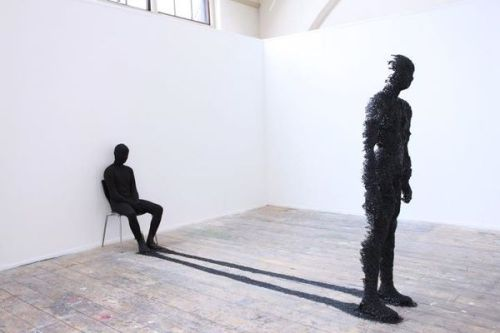 "fornicating:  Shadow Sculpture by Rook Floro ""My sculpture/performance piece is inspired by Carl Jung's psychological theory about the shadow. It concerns with the repressed ideas, weakness, and desires of oneself that the conscious mind refuses to acknowledge. It represents my 'shadow' which involves my hidden desires to be different and become perfect in my own right. We always feel the pressure to be perfect by everything around us such as the media, social network, advertisement, friends, and family."""
