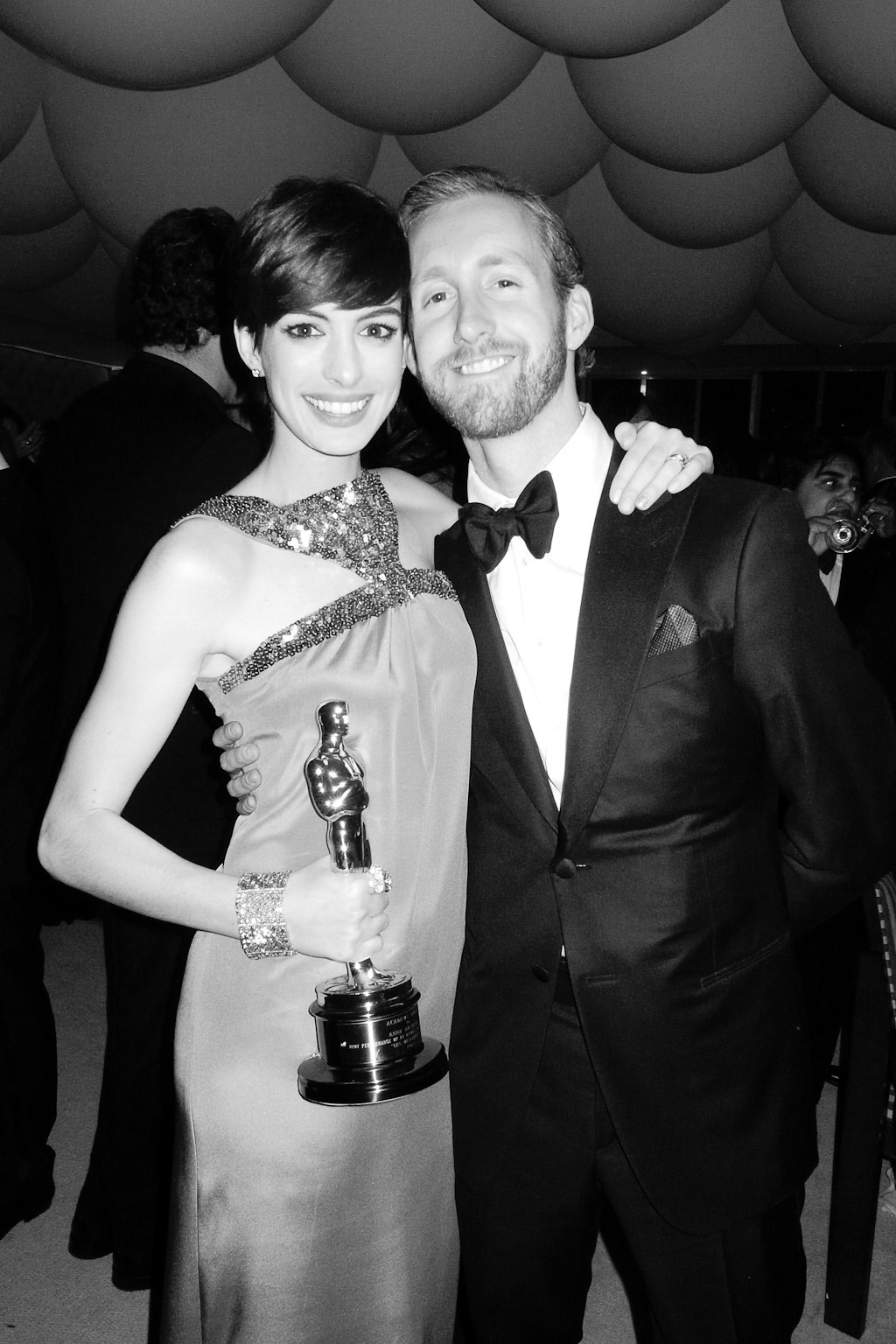 terrysdiary:  Anne Hathaway and Adam Shulman at the VF party.