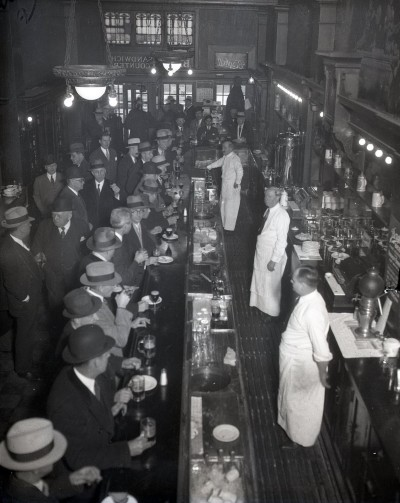 After work drinks at the Berghoff, 1934, Chicago. If you live in Chicago and you've never been to the Berghoff, you owe it to yourself to visit.