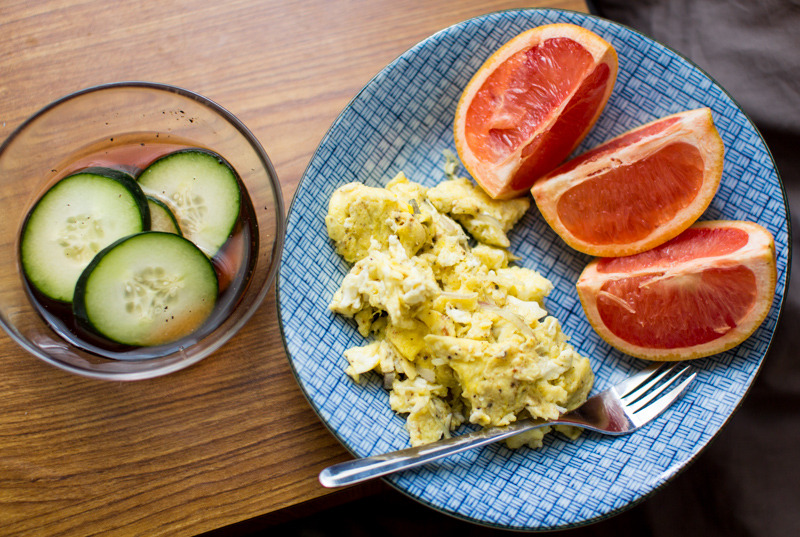 Paleo Breakfast. Pepper seasoned scrambled egg and grapefruit sided with cucumber soaked in red-wine vinegar (I consider the vinegar paleo).