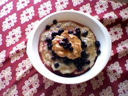 offtheweightlist:  Blueberry French Toast Oatmeal - 1/3 cup rolled oats; 1 cup water- cooked with: 1 tbsp raisins; 1 egg; 1 tsp maple flavor; 4 drops liquid Stevia; dash salt- topped with: 1/4 cup thawed frozen wild blueberries; 1 tbsp natural chunky peanut butter; 1 tsp maple syrup Cooked in the microwave and refrigerated overnight. Some of the liquid from the blueberries mixed in with the syrup around the edges… the best.