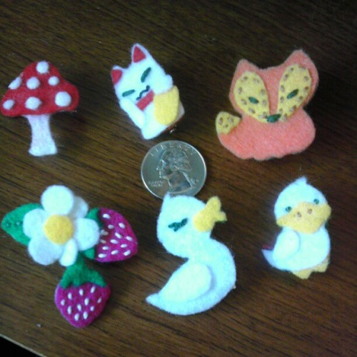 I decided to get a picture of my tiny felt menagerie with a quarter to show just how tiny they are, for funsies