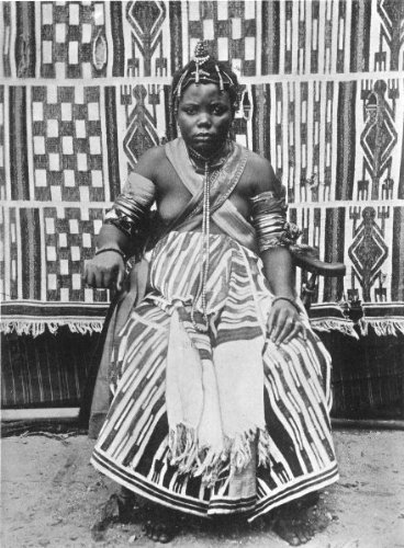 A Nigerian Bride, 1900The clothes worn by the bride, the daughter of one of the most important chiefs in the oil rivers protectorate, now Southern Nigeria, is of native manufacture. Some of these cloths are very beautiful and exceedingly strong. The necklets, bracelets and hair ornaments are large pipes of real and valuable coral. The armlets are of ivory cut from elephants' tusks'Vintage Nigeria
