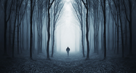 man in a dark forest by RBJKINGSTON on Flickr.