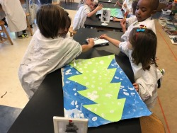 Preschool and prekindergarten students helped to decorate for the winter concert by painting snow