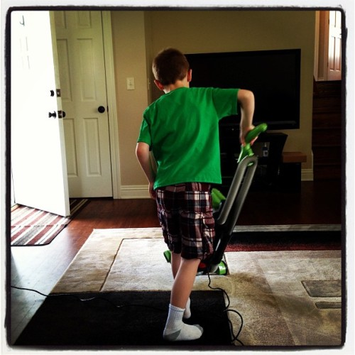 "The ""little big man"" doing his chores."
