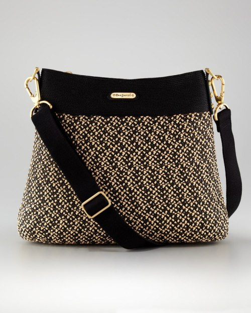 "Keep your hands free with this beautiful cross-body pouch - crafted with Eric Javits, Inc. signature ""Squishee"" material to look GREAT no matter what you put it though ;) An exterior pocket and a clip for your keys mean no more digging to find what you need!"