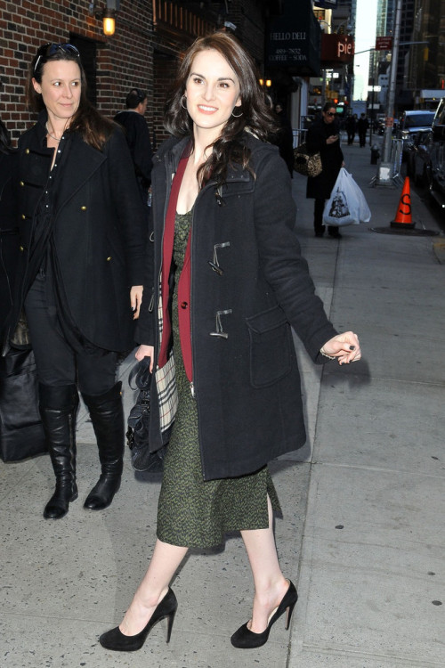 How many Burberry coats does Michelle Dockery own? BTW that lady on the left is Downton Abbey publicist Victoria Brooks. And apparently she also paints Michelle's nails.