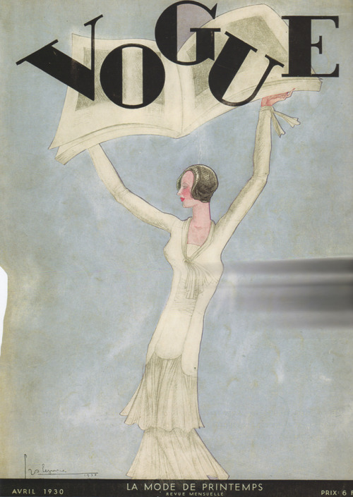 books0977:  Vogue. Published March 29, 1930. Pictured is the French April 1930 issue. A woman in a white tiered gown holds a large book overhead against a pale blue background. Illustration by Georges Lepape (French, 1887-1971). Lepape, a fashion designer, poster artist, engraver, and illustrator, contributed splendid colored plates in stencil to the Gazette du Bon Ton. He then collaborated with major fashion magazines of the time including Harper's Bazaar, Vanity Fair, Femina, and Vogue.