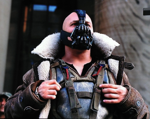 tomhardyvariations:  BEING BANE   You have a lot of very physical scenes in this movie. How is it doing those with that costume and mask on?Tom Hardy: It's uncomfortable because your body's really restricted. It takes a while to get the sweat on and get loose and fit. It's heavy and it's tight and the costumers need it to look good and solid. So it looks great when it's tight but it's not practical to move it, and you need a couple of hours of moving about before the suit will then move with you. Then the costumer will come in and tuck bits and tweak bits so it looks great, but then it's all functional and you start sweating. Then you get drenched with sweat on the inside and it creates another layer between me and the costume, so that's when it gets comfortable, funnily enough. A bit like when you have a scab and you pick off the scab. It's like ripping off a plaster; it's like that sort of… freedom. But the first couple of hours is a bit of a pain in the arse. Going for a pee is really a pain in the arse. Really? Why?You got zips and undershorts, underarmour - body armour - under that. It's all a bit of a faff. Forget about taking a shit, that's not happening. [laughs]. Is that why Bane's so angry?Oh yes, fucking retentive. Totally. Miserable. How easy is it to breathe through the mask?Um, it's more psychosomatic. If I panic then it's not easy and if I'm chilled then it's fine. It's got plenty of room to breathe but if I'm a bit panicky doing something, or a bit too high up or whatever, then I'm going to, you know, gasp a bit more. But once again I get used to the mask, I'm happy in it. How would you define the fight style? Obviously you did Warrior before this… immediately before?I did Inception after Warrior, then a play, The Long Red Road, with Philip Seymour Hoffman in Chicago. Then Tinker Tailor, This Means War, then The Wettest County [now titled Lawless], then this. Warrior took a year to edit. Took a long time to edit. So - the [Bane] fighting style. How is it different to Warrior?It is brutal and military. It's more military in many ways. MMA [Mixed Martial Arts] is very athletic. It's an athlete's sport. And you've got your Krav Maga and whatnot from Bourne, the Bourne world. Very tight movement, very contained but aimed to kill. To kill, do you know what I mean? And maim. Then you've got the Keysi lot that Batman does I suppose, which is a lot of elbow business. But Bane is brutal. It's not about fighting. It's about just carnage with Bane. Which is different to [Warrior's] Tommy Conlon, who is in the eye of the storm when he's fighting. He has peace of mind. Until he meets his brother and then it's all out of the window. He loses the fight because it implodes on him, you know? Whereas Bane's not that. Bane's a superhero villain. So that's what the violence is there to imply, and the style is heavy handed, heavy footed.