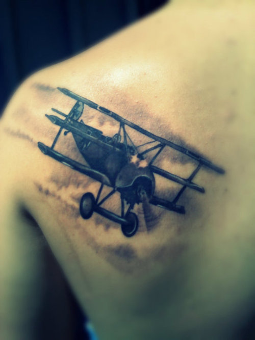fuckyeahtattoos:  The Red Baron is a distant relative of mine.   Done by Angel at Fat Cat in Fair Oaks, CA  www.fuckkarma.tumblr.com (Photo by www.calmdownhun.tumblr.com)