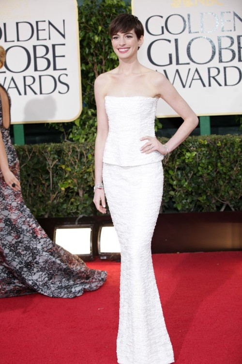womensweardaily:  On the Red Carpet at the Golden Globes Anne Hathaway in Chanel Photo by Katie Jones