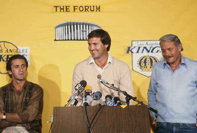 Jerry West speaks at a 1981 press conference as Pat Riley and Jerry Buss look on. Buss passed away on Monday at the age of 80. (Manny Millan/SI)
