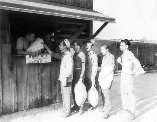 VMB-613's police shed doubled as a laundry.  Seen here, Sergeant Roy R. Emmerling and Corporal James E. Horton collect laundry from fellow squadron members.