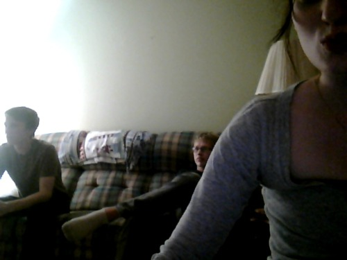 When boyfriend and brother play video games, and Sarah is taking pictures of it.