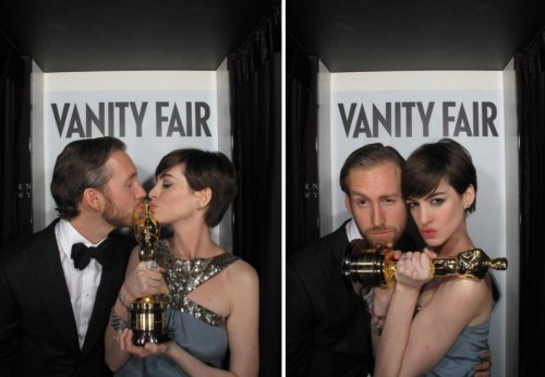 Kiss, Kiss!  Take a peek inside the Vanity Fair Oscar party photo booth.