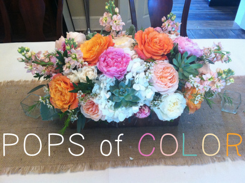 Event Designs by Katherine has created this GORGEOUS colorful arrangement for a June wedding this year. We love the combination of peach, mint, orange, and pink. Fun & vibrant flowers make the whole event cheery!