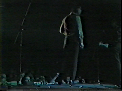 johndarnielle:  To the left of Nick Cave's left foot, at the lip of the stage, looking up in reverent, fevered wonder, right cheekbone partially obscured by a power supply: it's John Darnielle, 16 years old, loving his life for at least the next 35 minutes and probably until at least 2 a.m.
