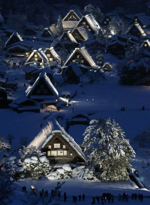 "letsbuildahome-fr:  Traditional Japanese houses delight as they're swathed in snow and light Japanese traditional wooden houses, ""Gassho zukuri,"" are lit up in the snow-covered village of Shirakawa in Gifu prefecture, central Japan, on Jan. 19. Gassho zukuri villages were listed as World Heritage sites by UNESCO in 1995. The village will be illuminated this year until Feb. 16. Picture: Jiji Press / AFP / Getty Images"