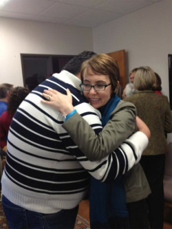 The man hugging Gabrielle Giffords is Daniel Hernandez, who is credited with saving Giffords' life. Daniel has released a new memoir, which aims to inspire young Latinos.