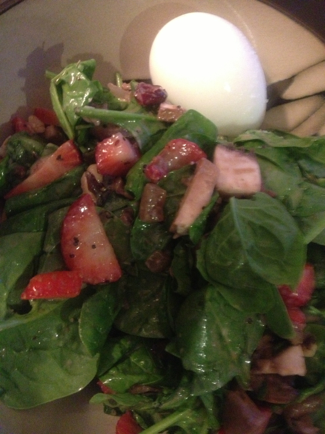 Dinner for today. Strawberry walnut and portobello salad with goat cheese and sweet onion poppyseed dressing. Soft boiled egg on the side for good measure.
