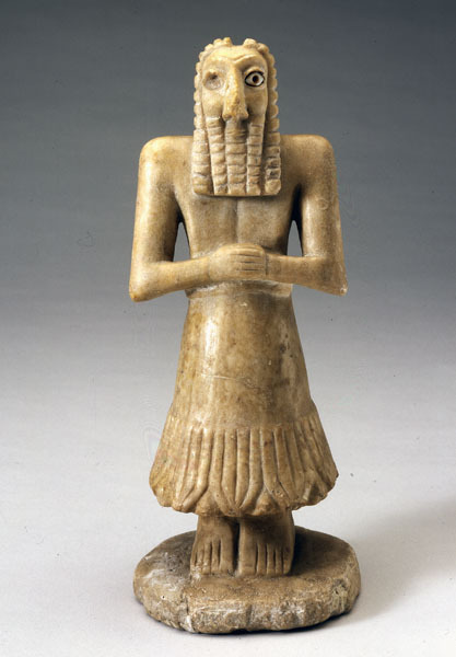Statuette of a Man Mesopotamian (Sumer), Dynastic period c. 3000-2500 B.C. Limestone and shell Found beneath the floor of a temple at Khafaje, northeast of Baghdad, this imposing statuette of a bearded man stands in a posture of austere piety. His carefully patterned beard and fringed skirt identify him as either a high priest or a god. Typical of such votive statues, the figure is highly stylized with little reflection of musculature or naturalistic proportions, its head expressing devotion and power through the exaggeration of facial features. Enlarged, staring eyes made of shell inlaid in bitumen project a concentrated intensity, which is accentuated by crescent-shaped brows. Squared arms and tightly clasped hands add to the figure's strength. Source: Worcester Art Museum