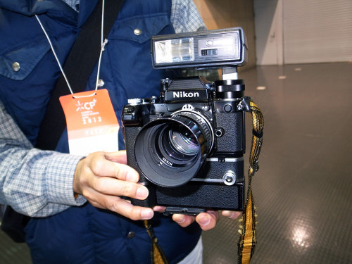 tokyo-camera-style:  February 2013: CP+ Photo Imaging Expo, Yokohama Nikon F2 with AS Photomic finder, 85mm f2 Nikkor lens, SB-7 flash, MD-1 Motor drive, MB-1 Battery Pack