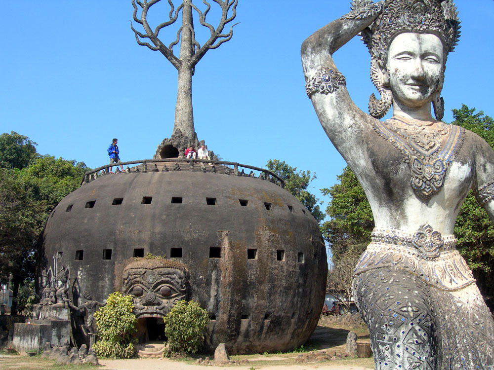 odditiesoflife:   Buddha Park Buddha Park, also known as Spirit City (Xieng Khuan), is a sculpture park located 25 km southeast of Vientiane, a small city that sits along the Mekong River in Laos. The park was started in 1958 by Luang Pu Bunleua Sulilat who was a priest-shaman. The park displays over 200 Buddhist and Hindu statues of deities, along with other beautifully carved strange figures. The main attraction is the giant reclining Buddha resting on the grass (first photo).