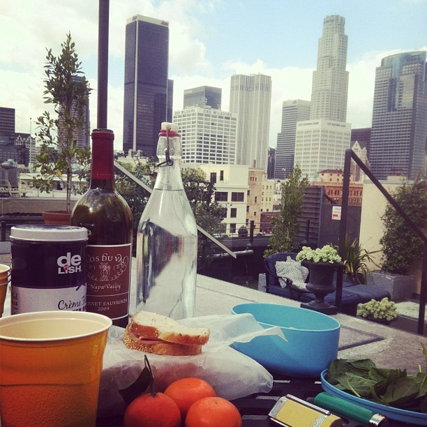 Rooftop picnic + wine + cigars (not me, thank you very much). #dtla #skyline #sunny #weather #losangeles #tangerines!
