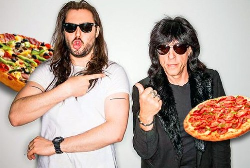 """When we said we loved the fact that Andrew W.K. photoshopped pizzas into this pic with Marky Ramone, he responded thusly: """"No! Those pizzas were literally flying through the air in the Spinner HQ! It was a flying pizza UFO party! :)"""""""