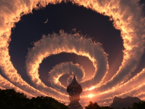 Cloud spiral in the sky. An Iridescent (Rainbow) Cloud in Himalaya. The phenomenon was observed early am 18 Oct 2009