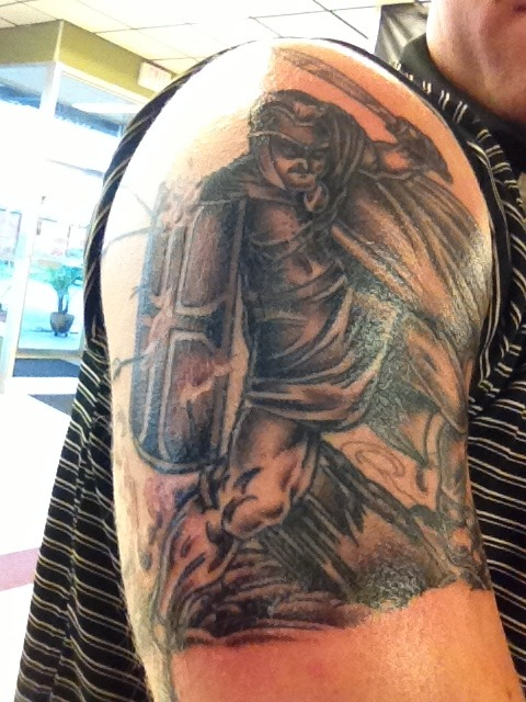 This tattoo represents the Armor of God passage in Ephesians chapter 6 which talks about standing firm in the faith and putting on the helmet of salvation, sword of the spirit, breastplate of righteousness, belt of truth, and feet equipped to spread the Gospel message. I love it because it is a daily reminder to stand firm in the faith! Be a soldier for Christ everyday.