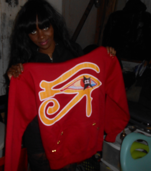 Female Rapper Bonnie Benji before with the new Colab hoodie