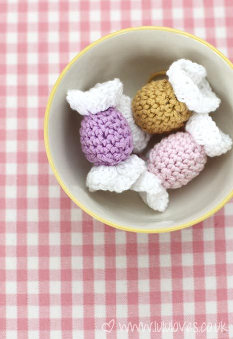 podkins:  Crochet Sweet / Lolly Decoration  - a free pattern with pretty pics from Lulu Loves via the link.  That blog is awesome to btw.