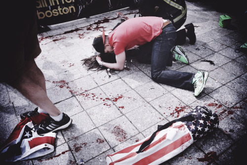 "Tragedy in Boston: Photographer's Eyewitness Account… Boston Globe photographer John Tlumacki, who photographed the explosions at the finish line of the Boston Marathon. Tlumacki, who has photographed more than 20 marathons in his 30 years at the Globe, describes the sheer chaos of the scene: ""I was covering the finish line at the ground level at the marathon. Everything was going on as usual. It was jovial — people were happy, clapping — and getting to a point where it gets a little boring as a photographer. And then we heard this explosion. It was sort of like, ok, what's that all about? It wasn't super loud but all you saw was the smoke. There was this big cloud of smoke and people screaming. The percussion from that explosion threw my cameras up in the air. Right in front of me, one of the runners fell on the ground — he was blown over from the blast. My instinct was…no matter what it is, you're a photographer first, that's what you're doing. I ran towards the explosion, towards the police; they had their guns drawn. It was pandemonium. Nobody knew what was going on. The first thing I saw were people's limbs blown off. Massive amounts of blood. It looked like BB holes in the back of some people. And a lot of anger. People were just angry. What's going on? Why is this happening at the Boston Marathon? Maybe 15 seconds after the first explosion, while I was still shooting pictures, another explosion went off. And then there was panic. The cops told everybody to get off the street, that there could be another one. I can't compare it to anything else I've ever been to. The horror. And the anger."""