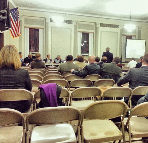 "On Thursday, March 7, there was a Planning Commission hearing at the War Memorial Building for TransForm Baltimore, the city-wide rezoning which at this point is not only well-underway, but rapidly reaching its conclusion. The large hall seemed relatively unnecessary as the seats were mostly unoccupied for the duration of the 4+ hours meeting despite the importance of the issues being discussed. The attendees appeared mostly to be developers, lawyers representing developers, lawyers representing businesses, property owners, business associations, a couple of community associations and a couple of pseudo-community associations. The purpose of the meeting was to go through all of the comments and suggestions interested parties have made regarding the new proposed zoning, to go over the recommendations to the Planning Commission the Department of Planning makes (either for or against) on those suggestions, and provide those who have an interest to testify to the Planning Commission before they make their final recommendations to the Baltimore City Council. The Department of Planning compiled 297 comments/amendments to be considered. You can see the full list here (and while it would be beneficial for us to see who made the proposed changes, that information is not provided despite the Planning Commission asking several times ""who proposed this""). The highlights are as follows: - Formstone has been requested to be removed as a prohibited material in new zoning code. And the Dept. of Planning agrees, even though they claim Formstone is no longer manufactured. So Formstone it up if you can find it, Baltimore! It looks like it will stay legal. - Hospitals/colleges feel they ""should be treated as floating zones"" for height as per a master plan they themselves construct. Nice, right?- The Planning Dept. recommends prohibiting bikes from promenade areas in Canton/Fells Point.- In order for Clear Channel to put up 1 digital billboard, they have to take down 3 even though a Planning Dept. consultant says a 10 boards down for 1 digital board up is a fairer deal for city. Clear Channel has 900 billboards in the city but can't replace any with digital. They claim they need new locations. As if to try and underline this point, a member of the Planning Commission pointed out that he couldn't tell you anywhere in the city where he's seen a digital billboard. Perhaps he just never drives on 83?- Places of worship are to not be permitted in business parks. A couple of the members of the Planning Commission seemed to take extra-offense at this. - Planning recommends developers get height/density allowance for adding transit stops to their projects. This actually sounds like a pretty good idea. - Planning found Bmore Local's big box zoning proposal ""interesting"" but premature since the city is still trying to get some big box stores (their words). During our testimony we pointed out that it seems to make more sense to us to zone for big box stores BEFORE we start ushering them into Baltimore City than to try and do that after the fact, especially giving the devastating economic impact they can have on communities. Our sense is that while Planning is legitimately interested in our plan, pressure is coming from higher up in City Hall to do nothing that may have any impact on big boxes coming into Baltimore City. So get ready, Bmore. Finally, on the other big controversial issue - the zoning out of non-complaint liquor stores - that hearing will be taking place on Monday, March 18, 2013, 5PM at the War Memorial Building (101 N Gay St.). The Planning Commission will vote on amendments and the entire bill to prepare its final report on for the City Council on March 21 at 5PM at the Department of Planning (417 E Fayette Street)."