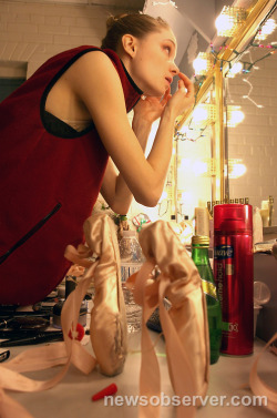 theballetblog:  Elizabeth Ousley applies make-up before her performance in the Carolina Ballet's production of the Nutcracker in Raleigh's Progress Energy Center for the Performing Arts on Saturday Dec 22, 2012. CASEY TOTH