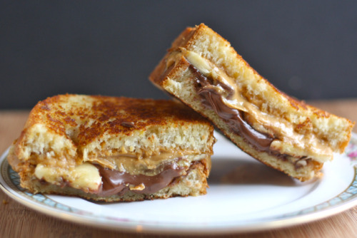 gastrogirl:  toasted peanut butter, nutella, and banana sandwich.  reminds me of that one time…