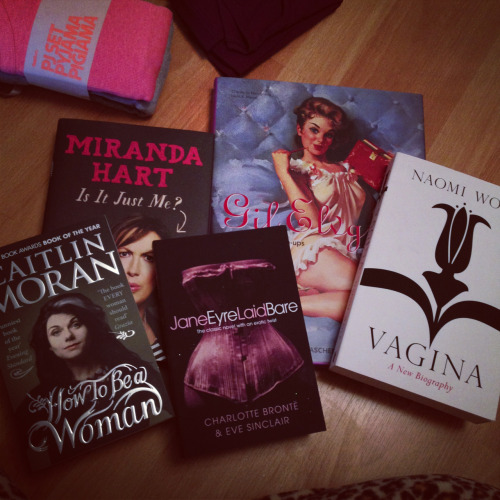 theartstudentlondon:  My eclectic book collection that I got from Santa. Gil Elvgren - Complete Pin Ups Caitlin Moran - How To Be A Woman Naomi Wolf - Vagina A New Biography Charlotte Bronte & Eve Sinclair - Jane Eyre Laid Bare Miranda Hart - Is It Just Me?  I feel like I need to add a few of these to my shelves..