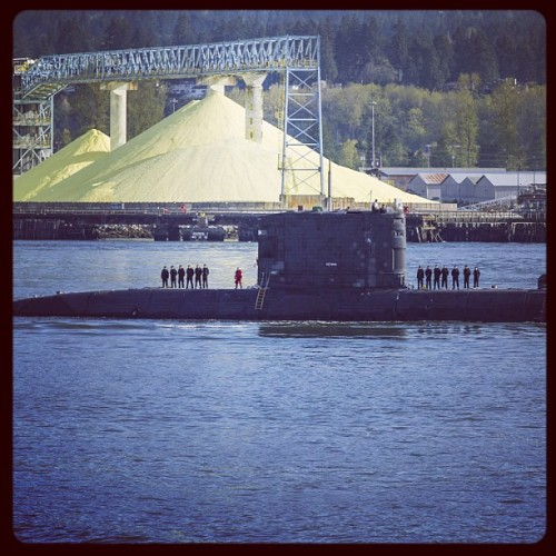A Canadian submarine is escorted into #Vancouver's harbour. (Ward Perrin/PNG)
