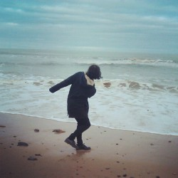 Skimming stones (at Whitley Bay Beach)